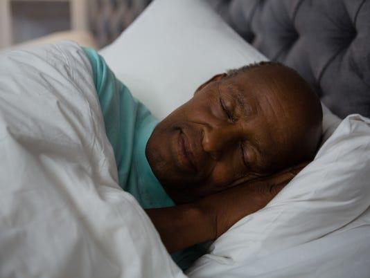 Senior man sleeping on bed