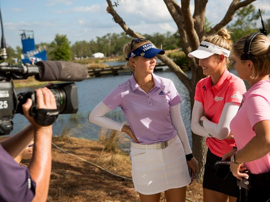 LPGA Tour pros Jessica Korda, left, and her sister Nelly Korda are interviewed by members of the media after completing the second round of the CME Group Tour Championship at Tibur—n Golf Club Friday, Nov. 17, 2017 in Naples.