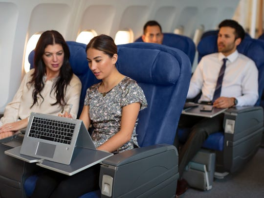 Travelers can bring laptops on planes, such as this