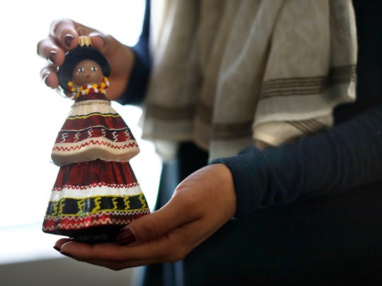 D'Anna Osceola shows off a Seminole Christmas tree ornament she keeps in her office Nov. 15.
