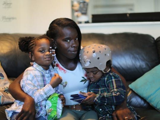 From left: Ashleigh, Taleighl and Ayden pose for a family picture. Not pictured is Taleighl's 9-year-old Treltarius, and her 15-year-old nephew, Trayvon.