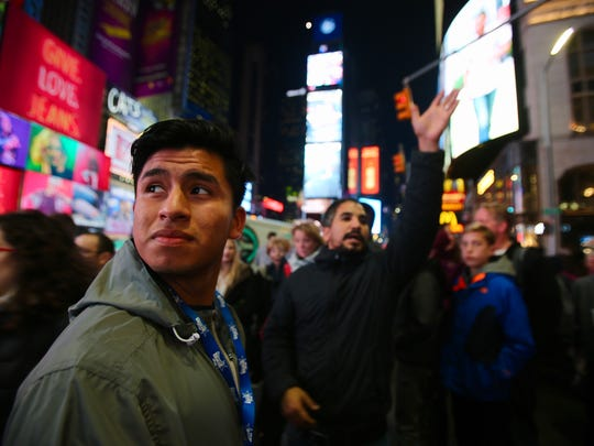 Luis Nicacio spends time exploring New York City before his performance in the Macy's Thanksgiving Day parade Wednesday, Nov. 22, 2017.