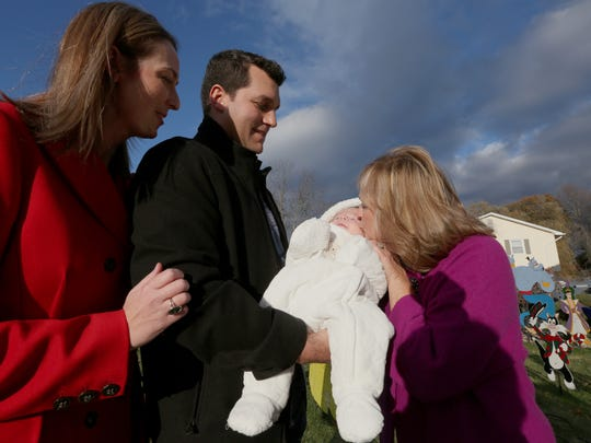 Chris and Nicole Mooney with their son, Chris, and
