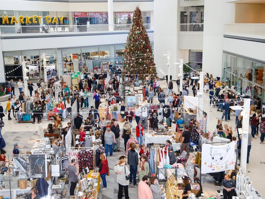 The Market Day Black Friday event takes over Capitol Square selling handmade goods from local artists.