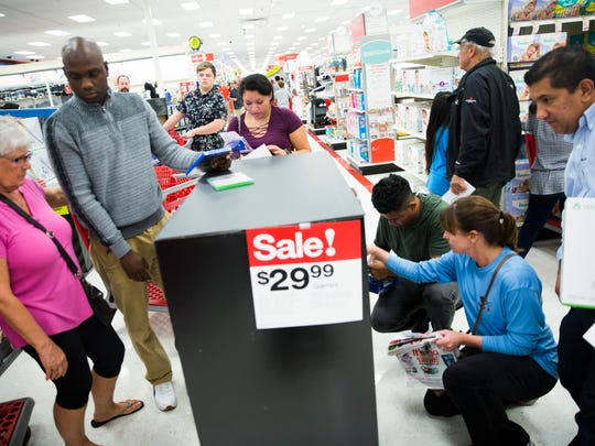 Shoppers crowd around DVDs and video games on Thursday, Nov. 23, 2017, at the Target on Pine Ridge and Airport-Pulling roads in Naples.