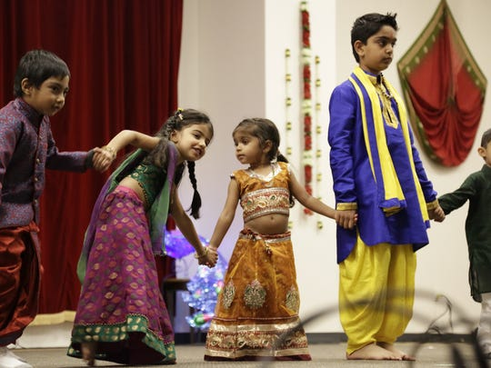 Gujarati Samaj Hindu temple at last year's Diwali celebration. This year, on Nov. 18, the temple marked its 10th year of rebirth with dancing and festivities.