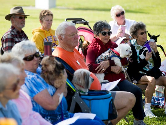 """Father Bill Faupel presides over the annual """"Blessing of the Pets"""" service at St. Paul's Episcopal Church Saturday, Nov. 25, 2017 in Naples."""