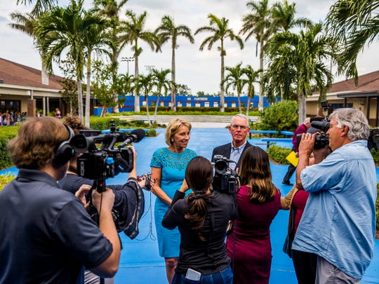 U.S. Education Secretary Betsy DeVos and U.S. Rep. Francis Rooney address the media at Lake Park Elementary School in Naples on Monday, Nov. 27, 2017.