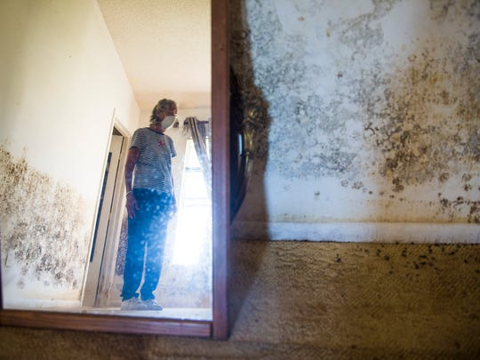 Marian Taylor stands in a bedroom of one of the homes on her property on Tuesday, November 28, 2017, just off of I-75 in Bonita Springs.