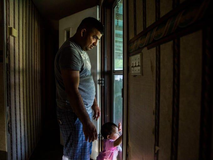 Abednego DeLaCruz with his daughter Jazlyn, 10 mos.,