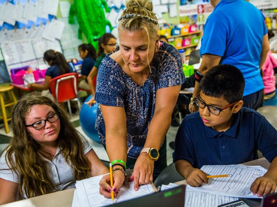 Ann Marie Morgiewicz works with her students at RCMA in Immokalee on Tuesday, Nov. 14, 2017. Morgiewicz set up a pen pal relationship with a Sandy Hook class after the shooting and is still continuing the effort today.