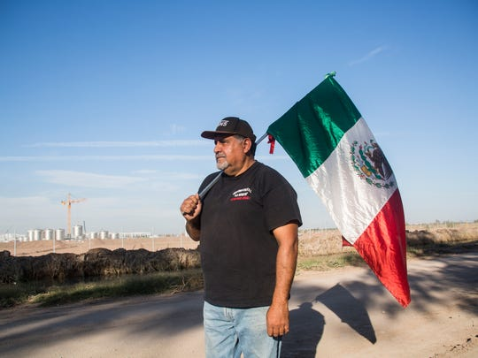 Filiberto Sanchez, a farmer in the Mexicali Valley, managed to trespass into the factory being built by Constellation Brands and climbed onto a crane. After a couple of days with no water and food he was brought down by the Mexican Red Cross. In this photo he is seen protesting in front of the factory with the crane visible at bottom left.