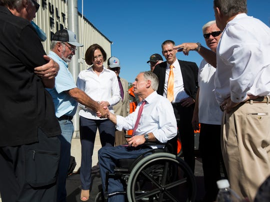 Gov. Greg Abbott (center) shakes hands with Fulton mayor Jimmy Kendrick after his speech about relief efforts in Aransas County, Tuesday, Nov. 28, 2017 at Fulton Fire Department. Abbott announced that $1 million worth of construction equipment was being donated by Kubota USA to help with clean up from Hurricane Harvey.