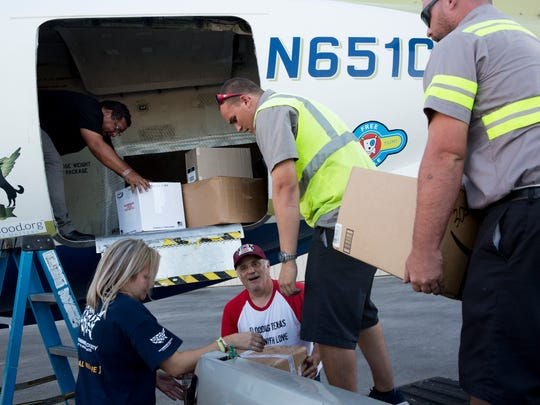 The Humane Society of the United States, with help from Wings of Rescue, loaded 3,700 pounds of veterinary supplies to be shipped to Vieques, a small island along Puerto Rico's eastern coast, to aid the Humane Society with the island's horse population at the Naples Municipal Airport Thursday, Nov. 30, 2017 in Naples.