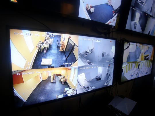 Video monitors in a control room show the different