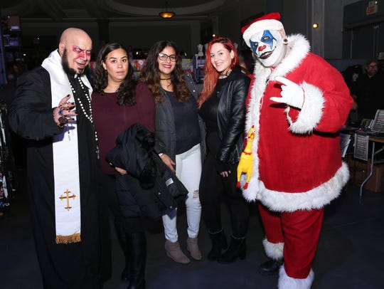 Father Evil (left) and Santa Carnage (right) pose with