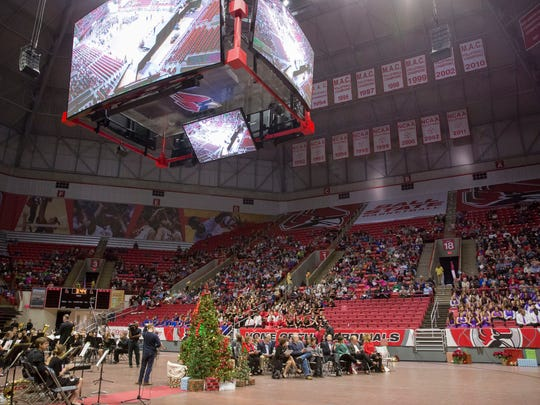 The audience fills in Worthen arena as the program begins for the 81st annual Muncie Community Christmas Sing on Dec. 3, 2017, at Worthen Arena.