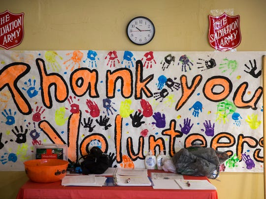 A sign hung on the wall thanks volunteers for their