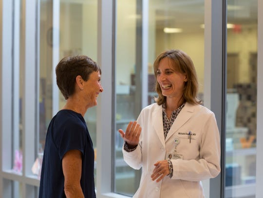 Kathy Graef speaking with Dr. Michele L. Donato, director
