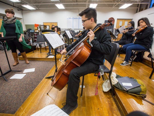 Jonathan Praseutsack, center, plays cello during chamber