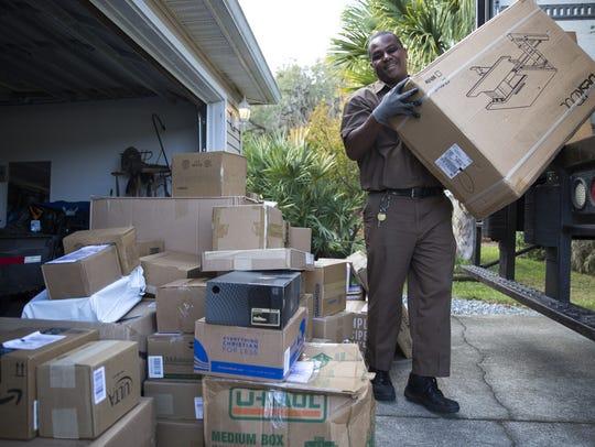 UPS Driver Derrick Baker drops off packages at Chris