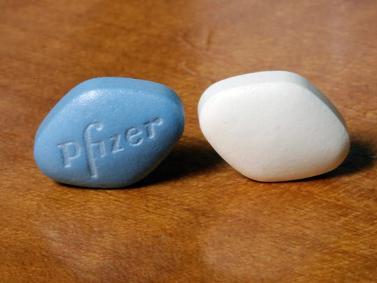 This Monday, Dec. 4, 2017 photo shows a tablet of Pfizer's