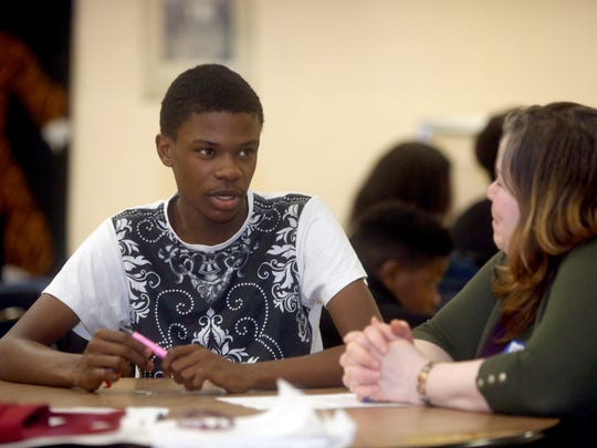 Ralph Thomas, 15, speaks with mentor Betsy Almodovar during a My Brother's Keeper mentoring session at Spring Valley High School Dec. 6, 2017.