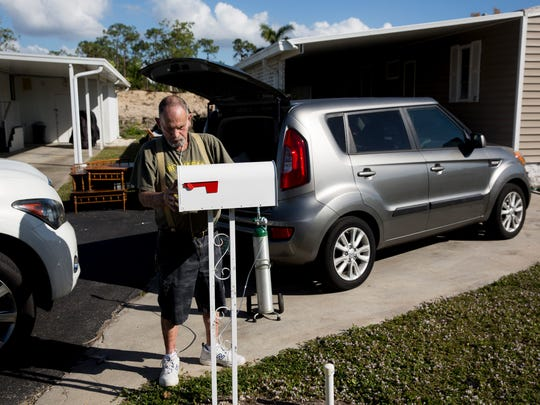 Ron Wilcox places a mailbox in front of his new driveway in Naples Estates, a mobile home community off Rattlesnake Hammock Road in East Naples, on Wednesday, Dec. 6, 2017. Wilcox and his wife, Brigitte, had returned to their previous home in Naples Estates and found that Hurricane Irma had destroyed it.