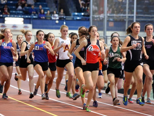 Athletes compete in the Girls 1500 Meter Run in the