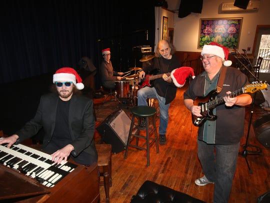From left, Jeff Schechter, Dan Hickey, Mark Dann and
