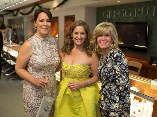 Grand board member Catherine Dean-Gooderhamm, left, with Elisa Komins Morris and Stacy Morris Hessler at the Grand Gala pre-party at A.R. Morris.