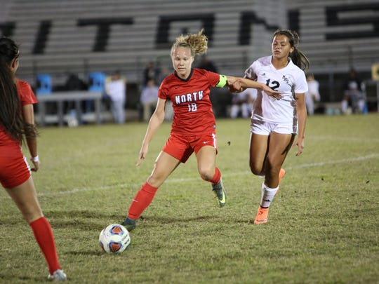 North Fort Myers' Emilee Hauser passes the ball in a match vs. Mariner.