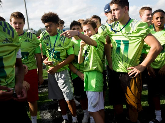 Middle-school football players from across the country showed up for registration and a pep rally to kick off the FBU National Championships at Gulf Coast High School Sunday, Dec. 17, 2017 in Naples.