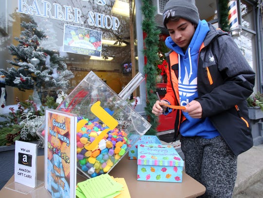 Elliot Gilinsky, 13, of Ardsley guesses how many dreidels