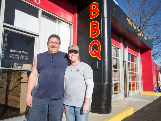 Mandy and Travis Thorrington stand outside their restaurant,
