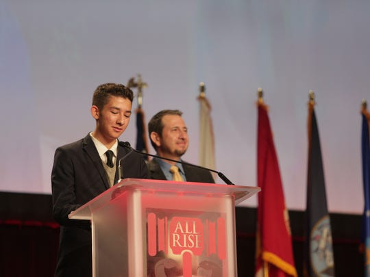 "Jose Montoya, right, and his son, Jose Alejandro ""Alex' Montoya, speak at the National Association of Drug Court Professionals Annual Training Conference."