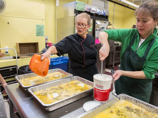 Lois Altman, who has been with the Muncie Soup Kitchen since 2006, helps volunteers prepare a Christmas Day breakfast on Dec. 22. The annual tradition for the soup kitchen keeps in line with their goal of feeding the community.
