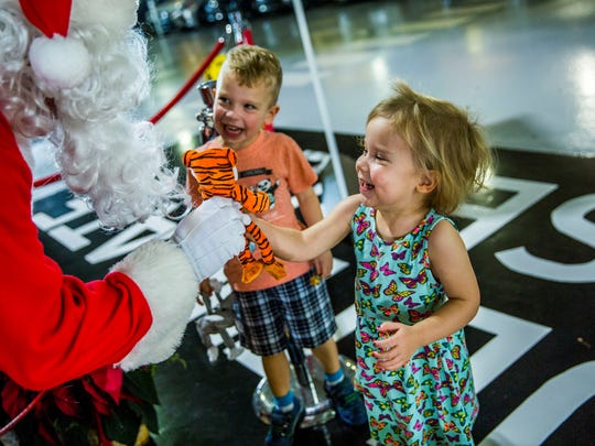 Jim Kirby of Estero greets Benedict, 4, and Johanna, 2,