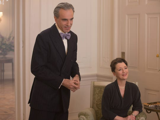 With withering stares and dry one-liners, Reynolds (Day-Lewis, left) and sister Cyril (Lesley Manville) bring levity to 'Phantom Thread.'