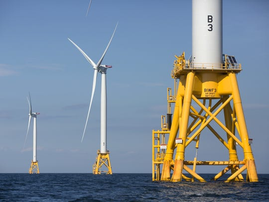 Three wind turbines from the Deepwater Wind project