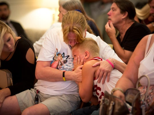 Mon., July 17, 2017: Covington. Kim Hill holds her