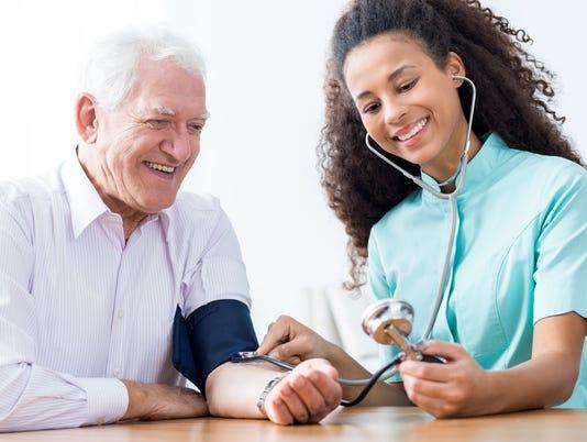 Man having measured blood pressure