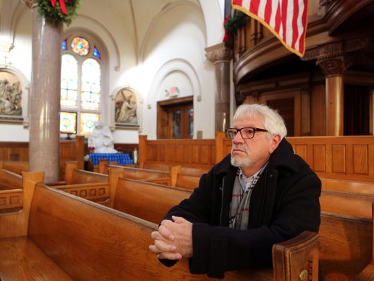 Tom Corbia, parishioner of the newly formed St. John Bosco Parish at 260 Westchester Ave., prays in Port Chester Dec. 27, 2017. Corbia was a member of Corpus Christi and has been coming to St. John Bosco since the two churches were combined.