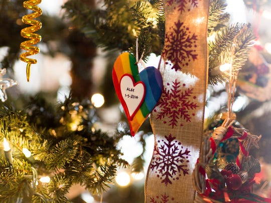 Lorrie Crisci and her son Alex are at the forefront of advancing LGBTQ protections in the Collier County Public School system. This Christmas tree ornament, heart-shaped and rainbow-colored, is inscribed with the date Jan. 5, 2014 — the day Alex came out to her..