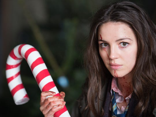 Ella Hunt (Anna) wields song, dance and a candy cane