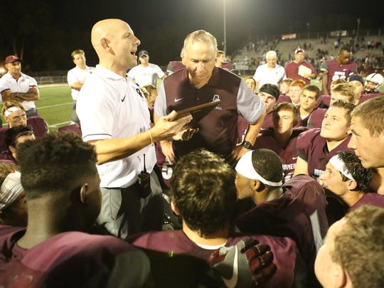 From 2015: Don Bosco Prep athletic director Brian McAleer presents a plaque to former coach Greg Toal celebrating his 300th career win.