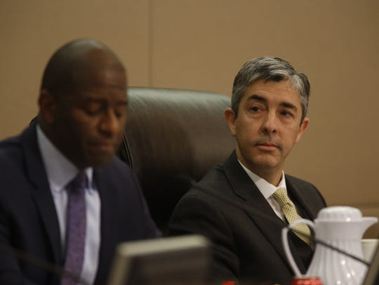 Interim City Manager Reese Goad listens as commissioners