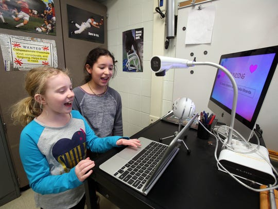 Fourth-graders Cassidy Sheldon, 9, left, and Isabella