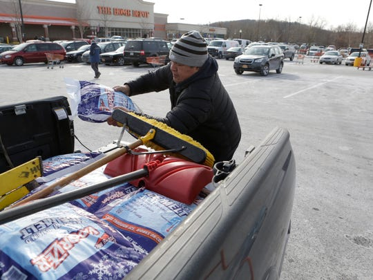 Jose Alvarracin of Poughkeepsie loads up on salt at Home Depot in Mohegan Lake in anticipation for the coming snowstorm on Jan. 3, 2018.