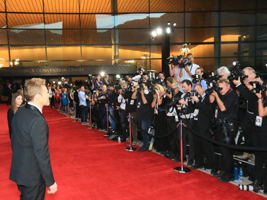 Representatives of 300 major media outlets crowded the 110-ft. celebrity red carpet.  Willem Dafoe is on the carpet in this photo.